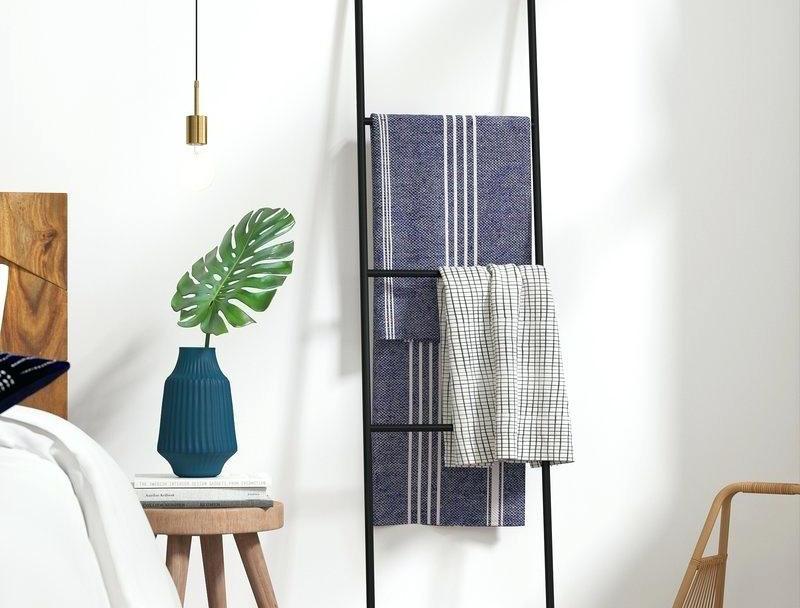 storage blankets on ladder